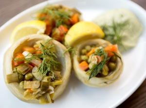 New York - July 22, 2015: For Features - Egyptian Artichokes with Fava Bean Puree, Carrots, Scallions and Peas served at Mundo restaurant located in the Paper Factory Hotel at 37-06 36th Street in Long Island City, NY. The restaurant pays special detail to recipes high in antioxidant levels. To go along with this they they use a LeveLuk sd water iodizer to raises the Ph balance of the water used to cook all their dishes. This process enriches the mineral content and raises the antioxidant levels of the water. This purified water is used extensively in the restaurant for cooking, making drinks and even used to make the ice cubes. Credit: Lorenzo Ciniglio/Freelance